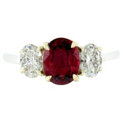 18 Karat Gold GIA Fine Vivid Red Oval Ruby and Diamond Three-Stone Ring