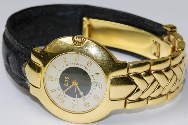 High quality and rare wristwatch by Gianni Versace. Limited Edition. Case, folding clasp and 18k solid gold band. Other band half made of leather. Automatic movement. With date display.