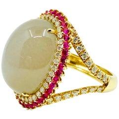 18 Karat Gold Grey Moonstone, Red Sapphires and Diamonds Ring