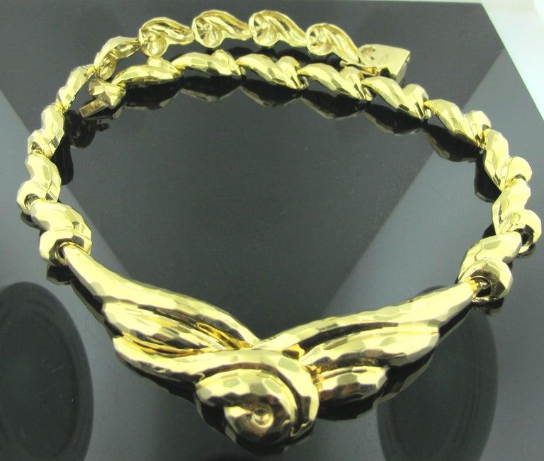 Hammered 18 karat yellow gold necklace.  77 grams.