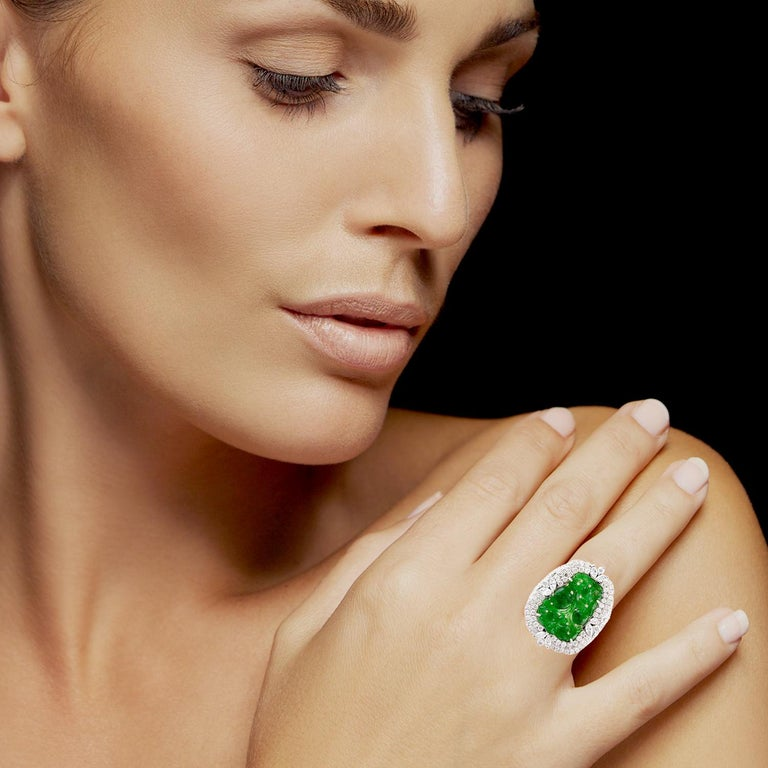 A true master piece handcrafted from 18-karat white gold. This ring is centered with a  4.1 carat carved Jade and 1.67 carats of sparkling diamonds. Instock  FOLLOW  MEGHNA JEWELS storefront to view the latest collection & exclusive pieces.
