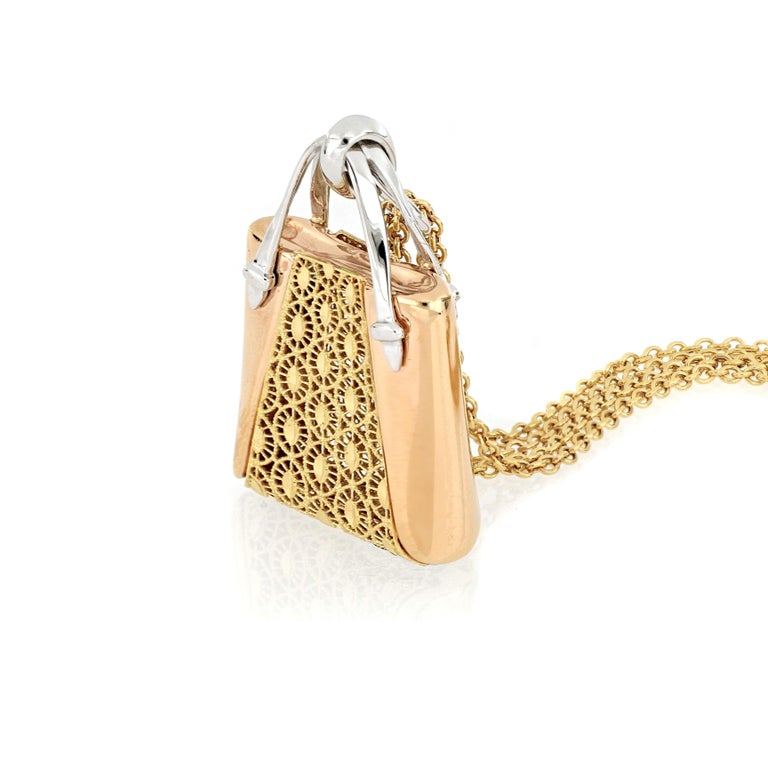 18 karat rose and yellow gold necklace with a handbag pendant, with fabulous design and very fine Italian craftsmanship, suitable for everyday wear.  O'Che 1867 was founded one and a half centuries ago in Macau. The brand is renowned for its high