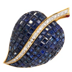 18 Karat Gold Invisibly Set Sapphire and Diamond Brooch