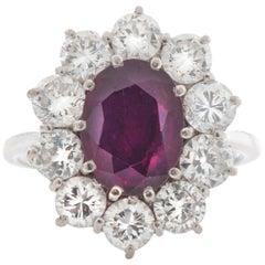 18 Karat Gold Ladies Ring with Thai Ruby of 1.5 Carat and 1 Carat of Diamonds