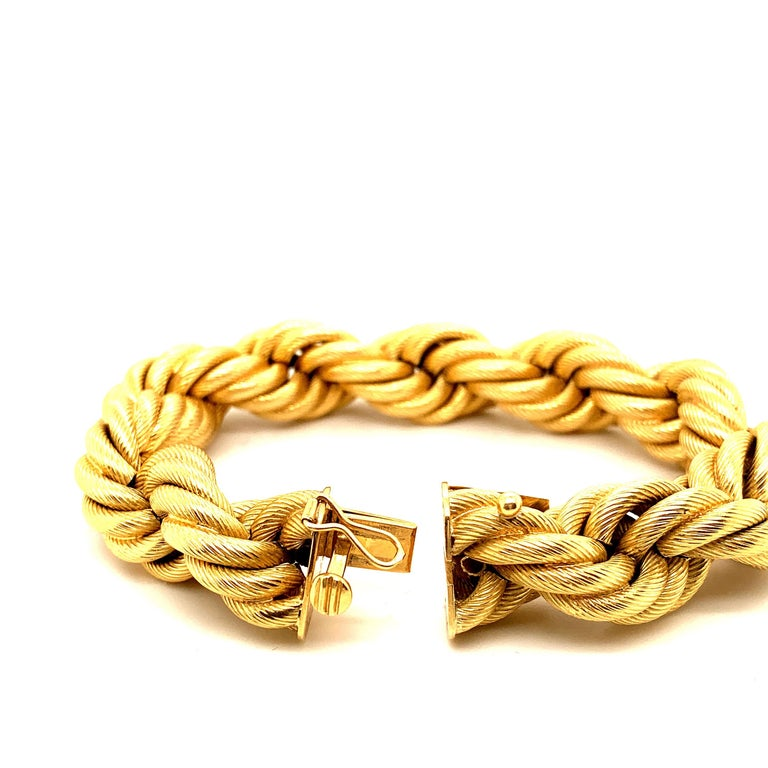 """Beautiful Italian twisted """"Rope"""" Gold bracelet. This bold bracelet Weighing over 66 grams of 18k Gold is an attractive statement piece.  Measuring 8 inches in length. What's old is new again."""