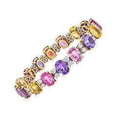 18 Karat Gold Multicolored Oval Sapphires 49.95 Carat and Diamonds Bracelet