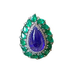18 Karat Gold, Natural, 14.19 Cts Tanzanite, Emerald & Diamonds Cocktail Ring