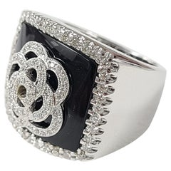 18 Karat Gold Onyx Ring with Diamonds
