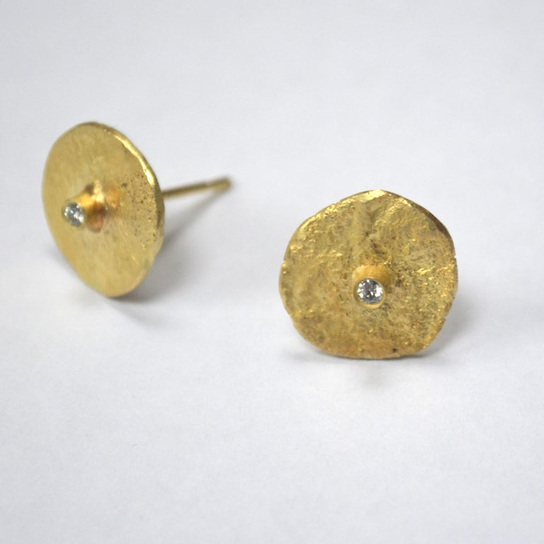 18k yellow gold organic texture disc earrings with two 0.03ct white diamonds.  These handmade organic texture stud earrings are made from 18k yellow gold. Made using Disa Allsopp's signature reticulation techniques to create the uneven, textured