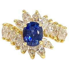 18 Karat Gold Oval Blue Sapphire and Marquise Diamond Cocktail Ring