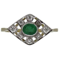 18 Karat Gold Oval Cut Emerald and Diamond Art Deco Style Cluster Ring