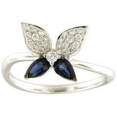 18 Karat Gold Pear Cut Blue Sapphire 0.23 Carat Diamond Butterfly Design Ring