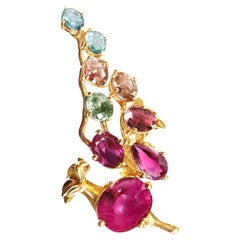 18 Karat Gold Pendant Necklace with Rubies, Sapphires and Malaya Garnets