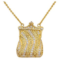 18 Karat Gold Petite Purse Pendant w/1.54ct Diamonds & 1.50ct Yellow Sapphire