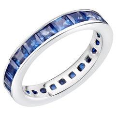 18 Karats Gold Princess Sapphire Eternity Band Ring Weighing 4.60 Carat