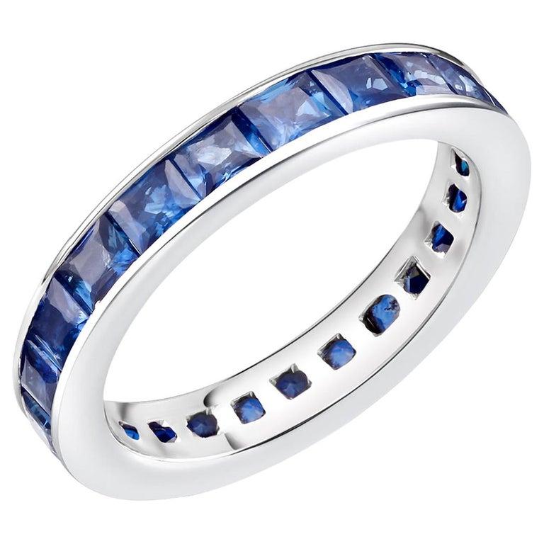 18 Karat Gold Princess Sapphire Eternity Band Ring Weighing 4.60 Carat For Sale