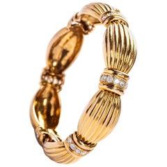 18 Karat Gold Ribbon Bracelet with Diamonds