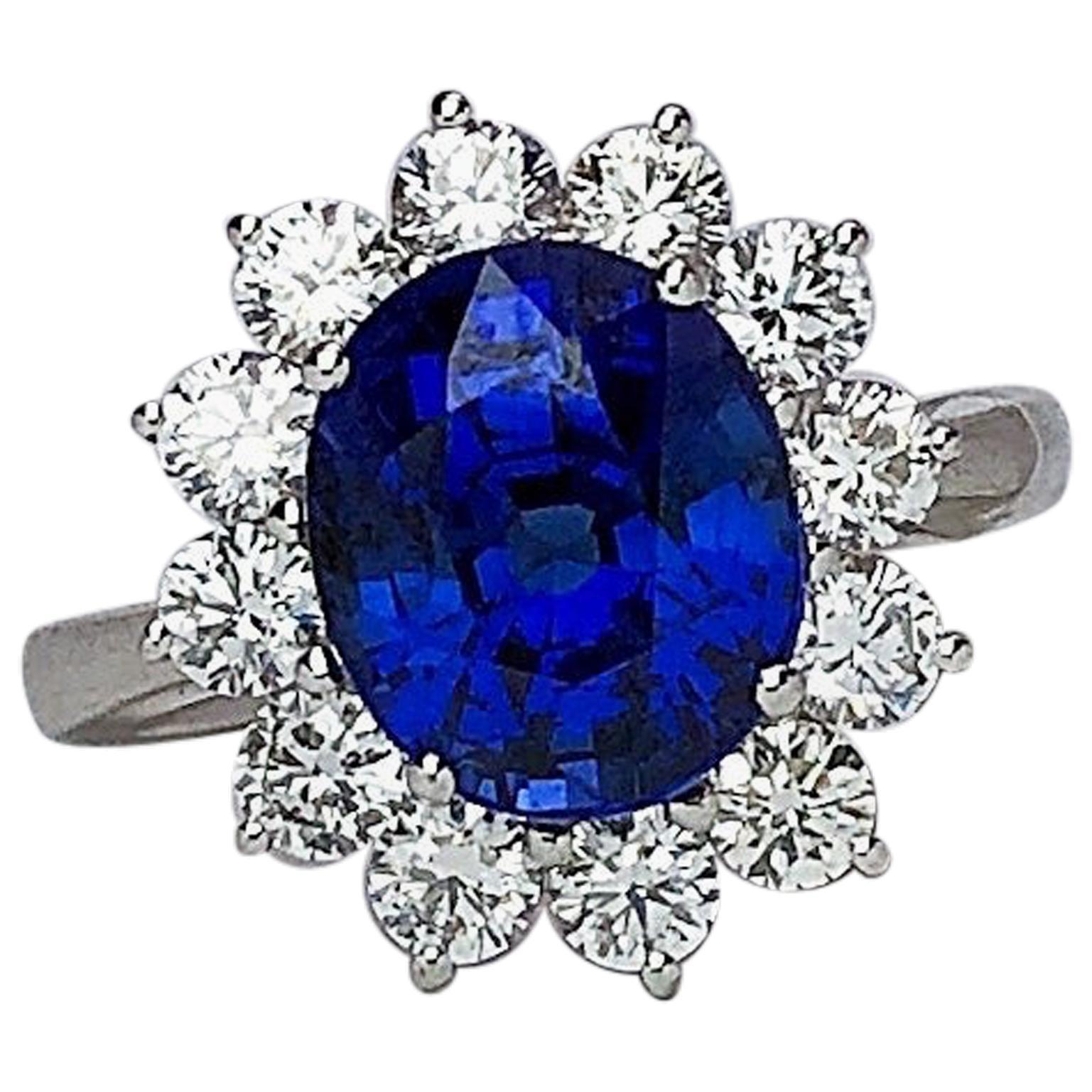 18 Karat Gold Ring with 5.12 Carat Oval Blue Sapphire with 1.27 Carat Diamonds
