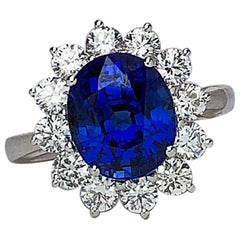 18 Karat Gold Ring with 5.12 Carat Oval Blue Sapphire with 1.27 Carat Diamonds