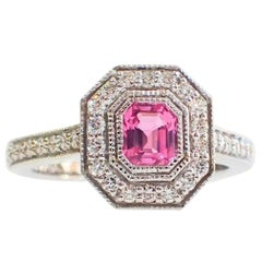 18 Karat Gold Ring with a 0.60 Carat Pink Sapphire and 0.35 Carat of Diamond