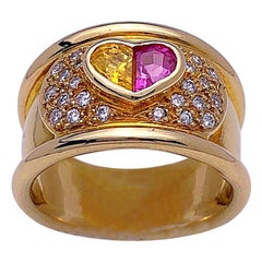 18 Karat Gold Ring with Pink and Yellow Heart Sapphire Center and Diamonds