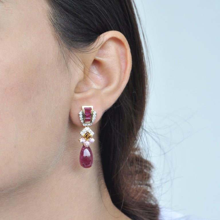 Pink delight -  These earrings will really cheer you up with its vibrancy and hues. Set in 18k gold, the top of the earrings feature tapered cut pink tourmaline baguettes channel set to perfection, surrounded by brilliant cut diamonds. To accentuate
