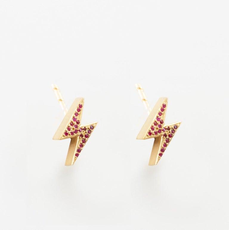 18k Yellow Gold Lightening Bolt Earrings feature two Ruby pave Lightening Bolt earrings set in 18k yellow gold, with secure round earrings backs.  Sold as a Pair 18k Yellow Gold, Ruby Pave