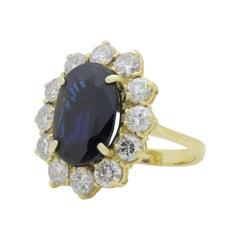 18 Karat Gold, Sapphire and Diamond Halo Ring