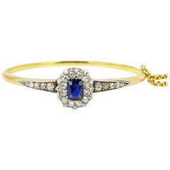18 Karat Gold Sapphire and Diamond Hinged Bangle Bracelet