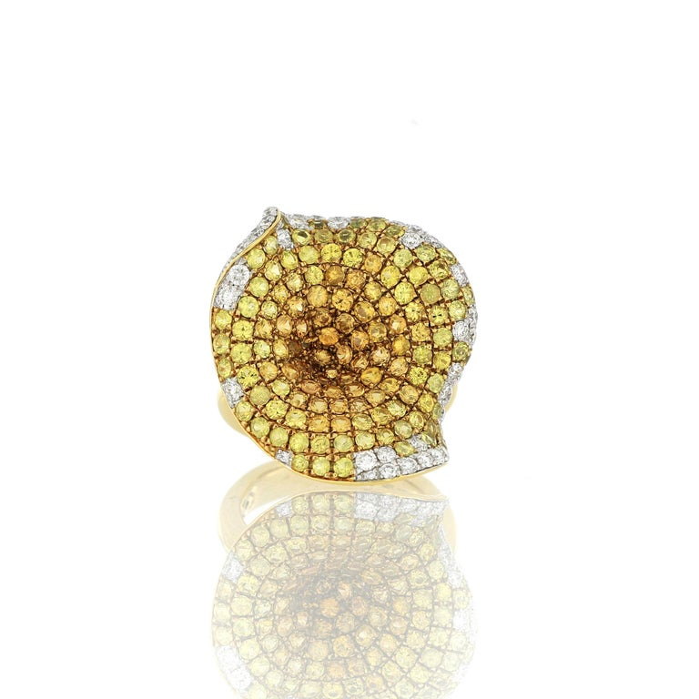 An elegant and classy yellow sapphire and diamond ring, composed of clusters of brilliant yellow sapphire and diamonds, the yellow sapphire weighing approximately 3.84 carats and diamonds weighing approximately 0.77 carats, mounted in 18 Karat