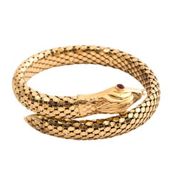 18 Karat Gold Serpent Bracelet with Ruby Eyes