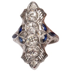 18 Karat Gold Shield Ring with 4 Old Euro Cut Diamonds w/ Tris of Blue Sapphires