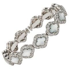 18 Karat Gold Spring Bangle Diamond and Mother of Pearl Bracelet