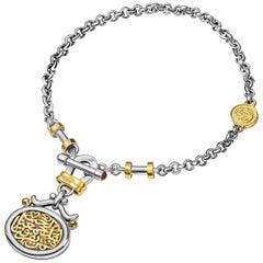 "18 Karat Gold Sterling Silver and Garnet T-Lock Calligraphy Coin ""Love"" Bracelet"