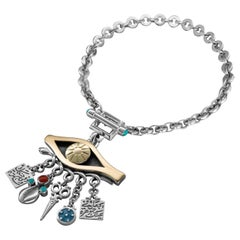 18 Karat Gold, Sterling Silver, Coral and Turquoise Evil Eye Charm Bracelet