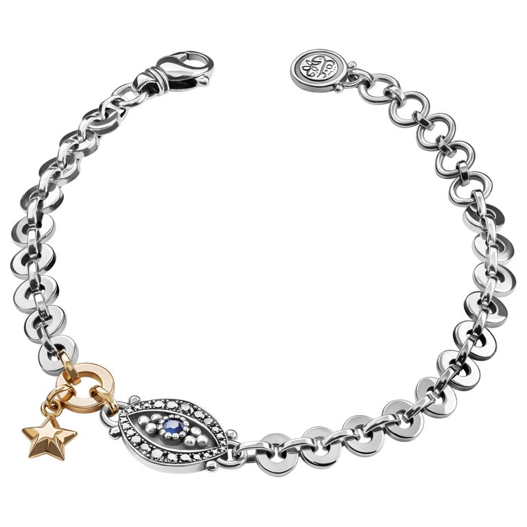 18 Karat Gold, Sterling Silver, Diamond and Sapphire Eye and Star Bracelet For Sale
