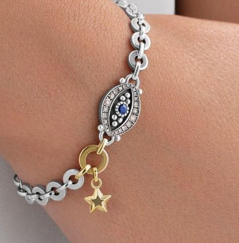 Round Cut 18 Karat Gold, Sterling Silver, Diamond and Sapphire Eye and Star Bracelet For Sale