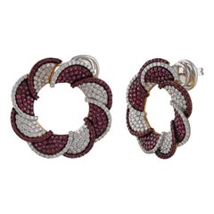 18 Karat Gold Swirling Stud Earrings in Diamonds and Rubies