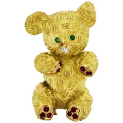 18 Karat Gold Teddy Bear Brooch with Diamond Nose, Emerald Eyes, and Ruby Paw