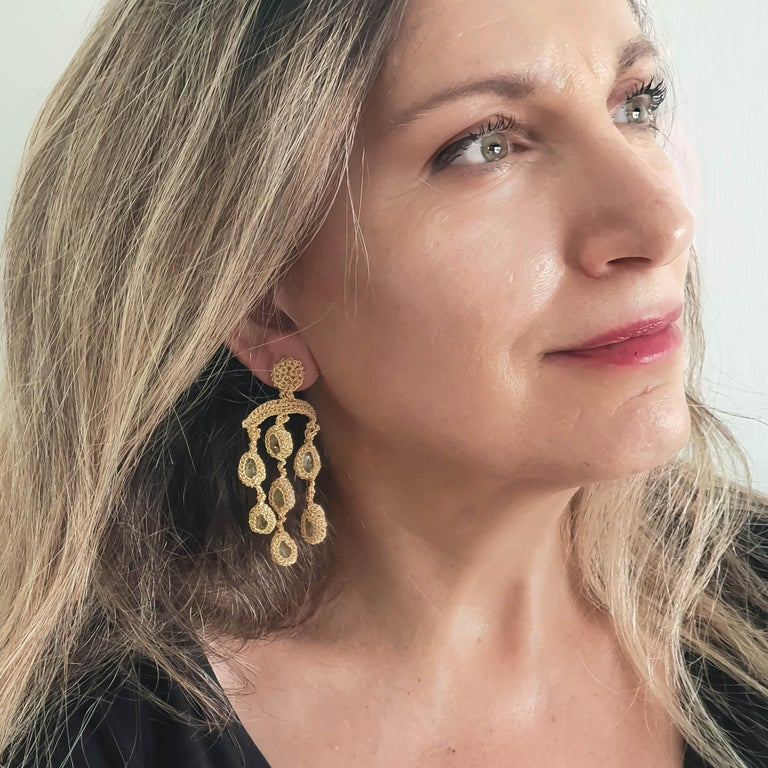 Beautifully crafted hand crochet gold thread (12.3 grams) earring with aquamarines (weighing in total 4.2 grams/21 carats. Elegant and Classic Chandelier earrings for everyday and special occasions.  Shenhav's inspiration comes from the world's