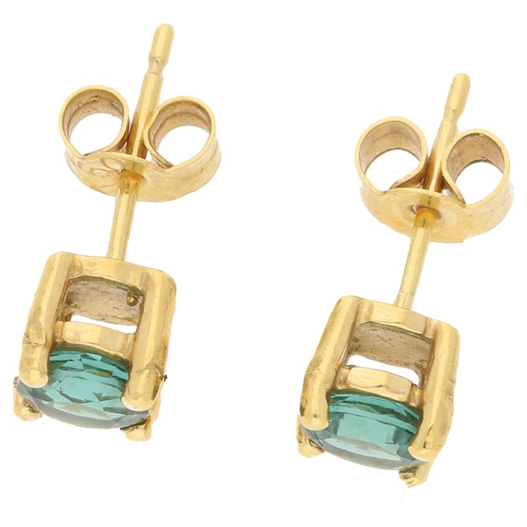 A pair of classic stud earrings set with a rich tone of tourmaline, each measuring approximately 0.5 carats; set in a four claw basket setting. Secured with butterfly backs.