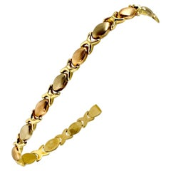 18 Karat Gold Tri Tone Hugs and Kisses XO Link Bracelet