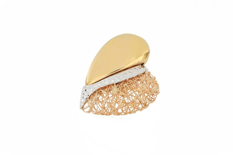 A stylish 18 karat gold heart shape tricolour ring, Italian made, composed of white gold, yellow gold and rose gold in different texture surface. O'Che 1867 was founded one and a half centuries ago in Macau. The brand is renowned for its high