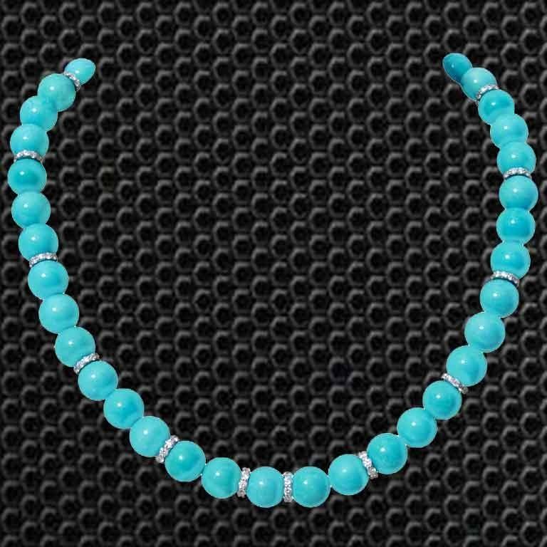 A single strand Turquoise Necklace, which consist 292.19 carats Turquoises and includes 3.97 carats Round White Diamonds. The necklace is made in 18K White Gold and weighs approximately 10.818 grams. The clasp is also made of 18K Gold.