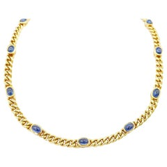 18 Karat Gold Twisted Curb Chain Necklace with Bezel-Set Oval Cabochon Sapphires