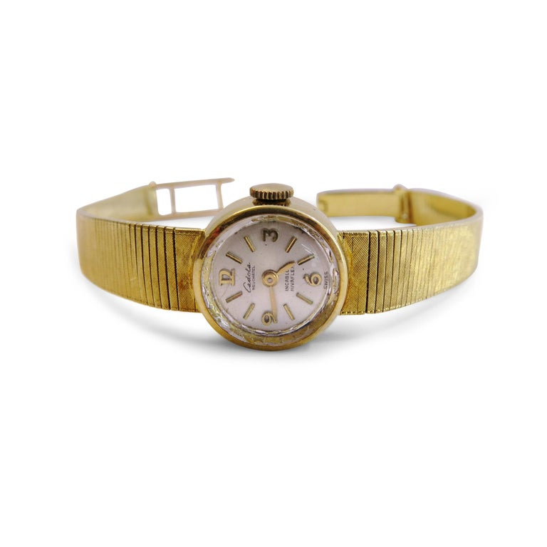 Cadola Neuchatel  18K Yellow Gold  Winding  Swiss  Size= 7 inches  Dial Diameter= 16mm Band= 7mm Weigh= 23gr