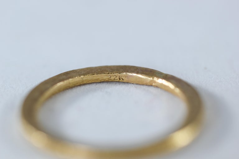 A bridal or wedding band ring in recycled 18k gold. Simplicity Medium Disk contemporary unisex wedding band ring is designed and handcrafted by AB Jewelry NYC. Ideal for a man or a woman. Wear it alone or as a fashionable stacking ring combining it