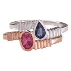 18 Karat Gold with 1 Carat Pink and Blue Sapphire in Oval Cut Stacking Ring Set