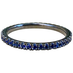 18 Karat Gold with Black Rhodium Plating Eternity Band with Chatham Sapphire