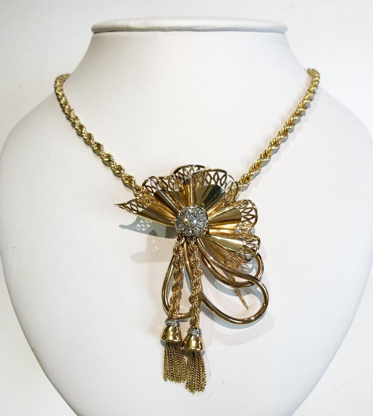 Vintage 18 karat yellow gold necklace, with a gold bow and brilliant diamonds in the center and also on the fringes, Italy 1940s Length 50 cm Pair of matching earrings is available